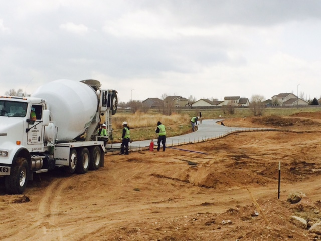 Pouring concrete for sidewalk